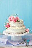 A two tier festive cake with mascarpone and lemon cream