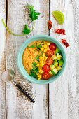 A savoury smoothie bowl with sweetcorn, avocado, tomatoes and chilli
