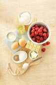 Ingredients for a mug cake with yoghurt and raspberries