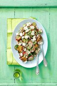 Baked potato salad with gherkins, red radishes and goat's cheese