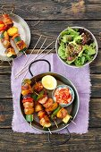 Chicken, potato and vegetable skewers with a side serving of lettuce