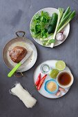 Ingredients for Thai salad: beef tenderloin, cucumber, glass noodles, chilli, lime, fish sauce and herbs