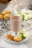 Ginger and cranberry madeleines served with a glass of hot chocolate