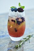 A refreshing cocktail with blueberry and lime