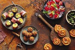 Paella rolls wrapped in Serrano ham, bean balls in tortilla coating, sangria melon and chilli con carne swirls