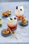 A Cassis Cooler served with mini muffins with chorizo