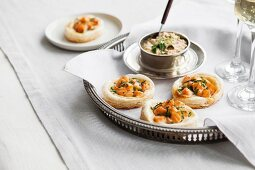 Diced salmon in flaky pastry nests with a dip