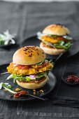 Crispy chicken burgers with peanut sauce