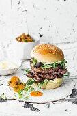 A double burger with beef, shiitake mushrooms, rocket and wasabi mayo