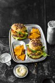 Burgers with beef, cheddar and lime mayo, avocado, and tortilla chips