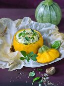 A yellow zucchini filled with sheep's cheese