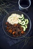 Potato and celery puree with vegan soy goulash