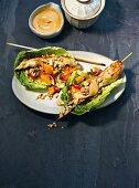 Chicken satay with mango salad