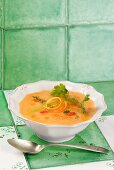 Pumpkin soup with potatoes, garlic, tomatoes, orange oil and coriander