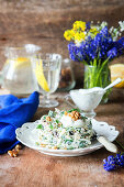 Salad with onion, cheese and walnuts with yogurt dressing
