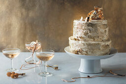 Two-tier cake with cream cheese filling and gold dust
