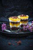 Vegan desserts made with chocolate cake, vanilla semolina cream, and mango purée