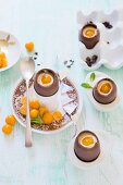 Chocolate eggs filled with cheesecake and physalis