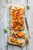 Puff pastry tart with vanilla creame cheese, fresh apricots and honey