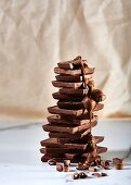 Stacked blocks of chocolate with chocolate sauce and chocolate curls