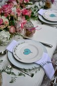 Place settings with painted hearts on a festively laid table