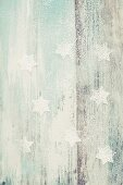 Powdered sugar stars on a wooden background with wood grain detailing
