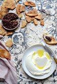 Lemon labneh with harissa olive and sumac pita chips