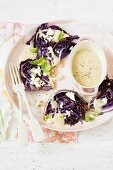 Fried red cabbage with onion sauce and feta