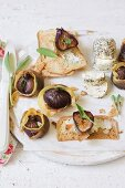 Figs with sage wrapped in Parma ham with goat's cheese and toast