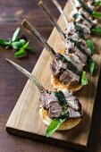 Lamb chops with mint and lychee pesto in a kataifi pastry nest