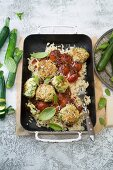 Zucchini and cheese balls with orzo noodles and spicy red wine sauce