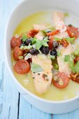 Salmon fillets with tomatoes, olives and spring onions