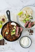 Mexican chili with chocolate and rump steak with tortillas