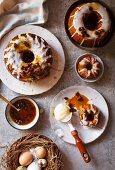 Hot cross bun cake with rum and raisin sauce and vanilla ice cream