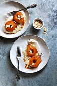 Roasted pears in caramel sauce served with yogurt and almonds