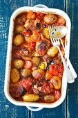 Chicken thights baked with potatoes, tomatoes and thyme