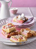 Rhubarb cake with icing sugar and cream