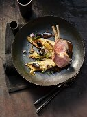 Heidschnucke lamb on chicory with black garlic