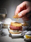 Mini burgers with tuna, pancetta and deep-fried onions