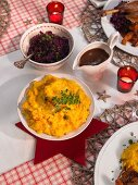 Potato and pumpkin puree, red cabbage, roast goose, and gravy