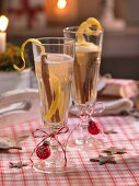 Sparkling wine with quince on a festive Christmas table