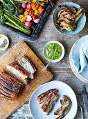 Roast pork belly with fennel, salsa verde and roasted vegetables