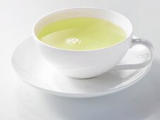 Green tea in a white porcelain cup