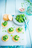 Crackers with pea and fava bean pesto