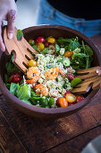 Quinoa salad with prawns, tomatoes and spring onions