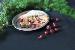 A piece of gooseberry cake with icing sugar