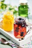 Various fruit jellies in glass jars