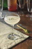 Sesame ginger vodka cocktail, garnished with matcha powder