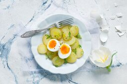 Potato Salad in a Serving Dish; Stacked Bowls