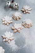 Staked cookies dusted with powdered sugar